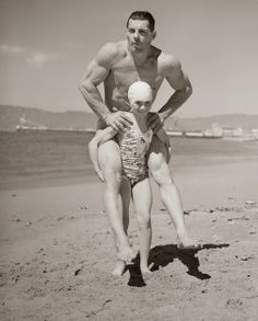 Patricia O'Keefe, who weighs only sixty-four pounds, holds two-hundred-pound Wayne Long on her back in an unusual exhibition of strength...1940