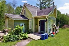 This tiny storybook cottage was handcrafted by its owner. It has 1 bedroom in 520 sq ft. | www.facebook.com/SmallHouseBliss