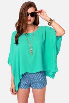 Square Necessities Seafoam Green Top: Forget about your wardrobe worries because this top is here to help spruce up your look. An extra-wide, box-cut top with short sleeves proves its hip to be square. Fabulously flowing Georgette has a scoop neck that pairs perfectly with your favorite statement necklace. Unlined. 100% Polyester. Hand wash cold $37