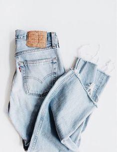 Light wash denim jean flat lay fashion photography