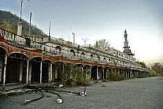 the abandoned compound in Consonno Milan Italy built 1926 Abandoned Buildings, Abandoned Places, Italian Theme, Beau Site, Medieval Castle, Milan Italy, Grand Hotel, Ghost Towns, Italy Travel