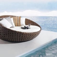 ahhh this would be the life. cool chair great view Outdoor Furniture