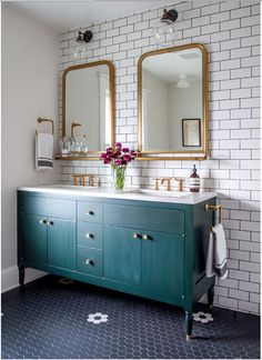 I love this turquoise green under sink cupboard - contrast to the golden rim mirrors - a special sense of vintage and modern together.