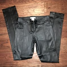 """Guess by Marciano Black Satin Pants - Size 4 EUC Guess by Marciano satin black skinny pants. Perfect for a night out!! Size 4. Material: 78% acetate, 19% nylon, 3% spandex. Measurements: 13"""" waist, 8"""" rise, 31"""" inseam. Retail $198. ✳️Also listed on other sites so will sell quickly✳️ ❌Trades❌PayPal❌ Guess by Marciano Pants Skinny"""
