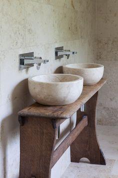 Jura Beige Honed Limestone (http://www.mandarinstone.com/product/_/93/jura-beige-honed-linestone-tile/?cid=) on wall with Ecru Honed Pluto Basins Marble (http://www.mandarinstone.com/product/_/360/ecru-honed-pluto-basin/?cid=) blending contemporary and rustic in a modern bathroom. #mandarinstone #stone #flooring #bathroom #limestone