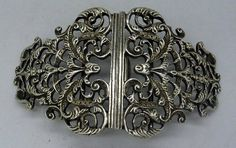 A silver buckle, London 1908
