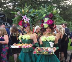 Blooming Fizz the summer canape whizz.  You might say the canape hostess with the mostess.  Can be joined by her sisters the Bourbon Roses to add a delicious addition to your summer event or wedding.  Visually stunning artistry for your canpes or as a walkabout act.  See more on our website http://www.calmerkarma.org.uk/garden-themed-entertainment.html