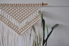 Medium size macrame wall hanging decor. Nice addition to every boho or scandi home. READY TO SHIP in 1-3 business days  >> color: natural cotton/ecru/beige/linen  >> measurements: Length of hanging wood stick is approx. 39cm / 15 inch  Macrame widht - 31cm/ 12 inch height -42cm/ 16 inch (with tassel)    >> materials: made with 3 mm cotton cord   If you need other size ask for custom order, I will be happy to make something special for you!   Th...