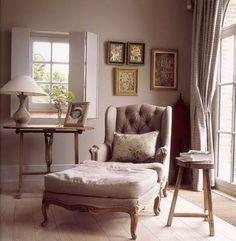 perfect reading chair + ottoman (Belgian linen); neutral palette; drapes; tripod table