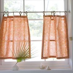 I have these Hawaiian beach dish towels to make some cafe curtains like these.