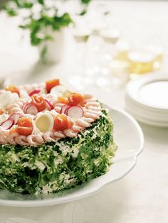 "A Fool's Feast: Smörgåstårta (Swedish Sandwich Layer Cake).  ""A round, sliceable sandwich with herbed cream cheese, smoked salmon with mustard sauce, fresh shrimp, and herring mousse."""