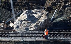 A worker inspects a 300 ton rock that fell on the railway tracks after an avalanche in Gurtnellen, Uri, Switzerland  Picture: REUTERS/Romina Amato