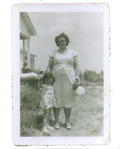 Me and my grandmother either coming or going to church in the 1950's.....gosh...no grass in the yard.....looks like we didn't have a lawn mower either!