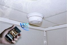 WIRELESS SMOKE DETECTOR HIDDEN CAMERA WITH AUDIO AND INTERNET (Buy/Rent/Layaway)   Open 24/7 (888) 344-3742  http://www.dpl-surveillance-equipment.com/9090866132A.html  • Remotely View Wireless Surveillance Video Online From Anywhere In The World By Internet • Built-In DVR - Record Up To 64 Hours Onto 32Gb Removable SD Card • Motion Activation • Time/Date Stamp • Scheduled Recording • Free iPhone / Android App.
