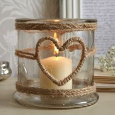 1001 Ideas for Summer DIYs to Brighten Up Your Home summer crafts big jar decorated with burlap ropes with heart-shape detail containing one lit candle The post 1001 Ideas for Summer DIYs to Brighten Up Your Home appeared first on Summer Diy. Pot Mason Diy, Mason Jar Crafts, Bottle Crafts, Mason Jars, Diy Candles, Candle Jars, Glass Candle, Homemade Candles, Glass Lanterns