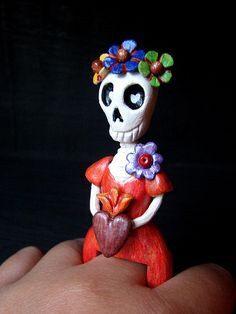 Catrina ring made with paper clay and colored pencils.