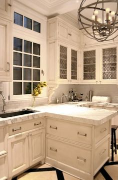 white cabinets, cool light fixture