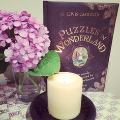 This gorgeous book! It's full of rhymes and riddles that will blow the cleverest of minds. Stunning illustrations too! #aliceinwonderland #book #books #riddles #puzzles #candles #hydrangea #flowers #alice #booklove #bookcover #pretty #booknerd #bookstagram #instagram #mosaic by beautifuldaypics
