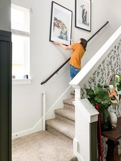 Tips and tricks for hanging photos going up your stairs Wallpaper Accent Wall, Small Entryways, Painted Doors, Painted Front Doors, Pictures On Stairs, Staircase, Large Family Pictures, Renovations, Hanging Pictures On The Wall