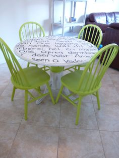 painted dining table and chairs with prayer hand painted on top