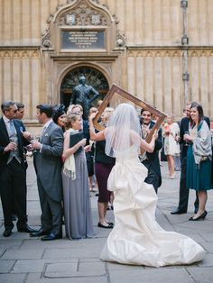 Use a simple Frame for a Super-Cute Photo Op Moment! See the wedding on #SMP here - http://www.StyleMePretty.com/2014/04/18/classic-english-wedding-at-the-bodleian-library/ Photography: Stephanie Swann Weddings - stephanieswannweddings.co.uk