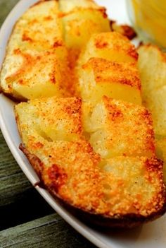 The most Ah-Mazing Roasted Potatoes! These are so stinkin' easy to make! Cook a pierced potato in the microwave for 6-7 mins. (flip every couple mins.) til soft all the way thru. Cut in half then into squares (just down to skin). Season with butter parmesan and Lawry's. Place in oven on aluminum foil-lined pan and BROIL for 10-15 mins. Enjoy!!!