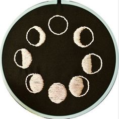 Hand stitched, embroidery art piece on 6x6 vintage blue plastic hoop! Pearl drop white satin stitch moons. Perfect art piece as a wall hanging or