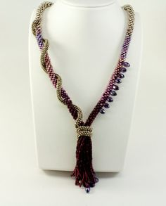 Hey, I found this really awesome Etsy listing at https://www.etsy.com/listing/195680801/designer-kumihimo-beaded-tassel-necklace