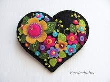 flor pin coração de multi preto