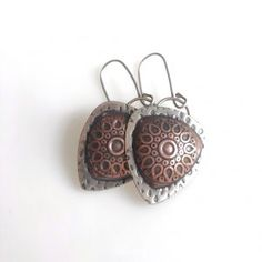 A sweet pair of mixed metal earrings - copper and argentium sterling.