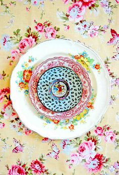 floral tablecloth and mismatched vintage plates
