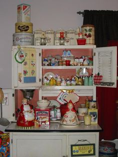 Sweet Hoosier cabinet filled with cottage collectibles and memories. Retro Kitchen Decor, Cute Kitchen, Old Kitchen, Kitchen Items, Kitchen Things, Kitchen Stuff, Country Kitchen, Vintage Tins, Vintage Dishes