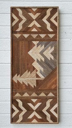 Rustic, handmade wall art of a mountain scene.