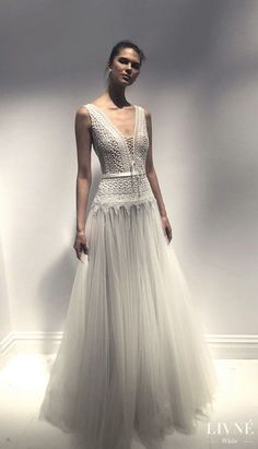 Livné White 2019 Wedding Dress - Eden Bridal Collection - Betty | Boho ball gown wedding dress | Unique Country bridal gown | Vintage wedding gown with wide shoulder, drop v-neck wedding dress with lace-up details, a full lace top and a long tulle skirt with cascading lace | #weddingdress #weddingdresses #bridalgown #bridal #weddinggown#bridetobe #weddings #bride #weddinginspiration #weddingideas #boho #bohochic #bohostyle #dress See more gorgeous wedding gowns by clicking on the photo