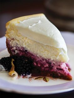 Lemon-Blackberry Cheesecake  This two-layer cheesecake looks cool and tastes better. It is nice to see the pure cheesecake layer above the berries, but if you're in a rush you really don't need to divide the batter; just add the purée and berries to the entire batter and omit that step.