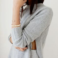 We would wear sweaters all year if we could. Especially grey ones with pretty gold bracelets.