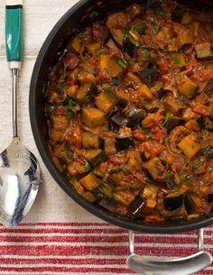 Keralan (south-west of India) Aubergine Curry (aubergines, salt, onion, garlic, oil, red chili, turmeric, cumin, English mustard, lemon juice, tomatoes, coriander)