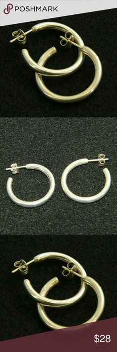 Sterling Silver Hoop Earrings Sterling Silver Hoop Earrings.  Stamped 925.  1 inch in diameter.  Hollow, smooth, comfortable.  Posts with sterling silver earring backs.  Used item: any wear shown in pictures.  Bundle Up!  Offers always welcome :) Stetling Silver Jewelry Earrings