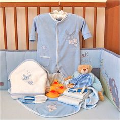 Bathtime Silver is a super gift for special little boys! The Silver set has a fabulous large hooded bath towel with essential rubber ducks! After bathtime baby can be snuggled into the soft velour sleepsuit nearly ready for bed! Bathtime Silver Contents:  x1 Large blue or white keepsake gift box x1 White/blue Hooded Towel x1 Blue Velour Sleepsuit (in 0-3 or 3-6 months) x1 Blue soft blanket x1 Gingham comforter x1 Manicure set (purple or blue) x1 Brush and comb set x3 Rubber ducks x1 White…