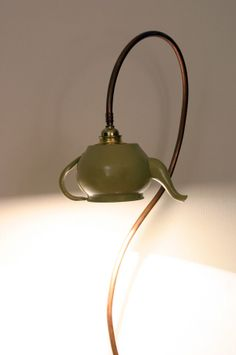 Cool lamps made out of tea pots! by Italian designer Tommaso Guerra