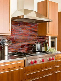 A wooden kitchen and accents in red and orange