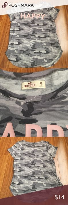 """Hollister camouflage shirt hollister camouflage shirt with """"happy"""" logo in pink. has a nice silky feel to it. never worn but no tag Hollister Tops"""