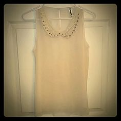Sheer Ivory Wurl Blouse Sheer Beaded and studed Wurl Blouse. This blouse/tank is very sheer, ivory in color and would look great with layering. Machine washable.  No rips, tears or stains. Smoke free and pet free home! WURL Tops Blouses