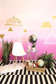 Create an ombré wall with virtually any pattern using painter's tape and a few shades of wall paint!