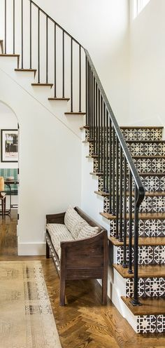Black handrail with black and white stairs Jute Home finds the perfect balance of antiques, art, and modern family life to make San Francisco living comfortably compatible. Tile Stairs, Entry Stairs, Wood Stairs, Basement Stairway, Tiled Staircase, Patio Stairs, Spiral Staircases, Painted Stairs, Wooden Steps