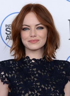 We're loving this modern twist on a classic smoky look. Emma Stone's smudged, indigo eyeliner on the lower lash line perfectly draws attention to her blue-green eyes. #Celeb #Beauty