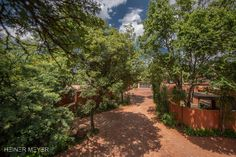 Wide open driveways and ample space with age old trees.