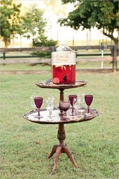 berry lemonade stand with vintage glassware #weddingceremony #drinkideas #weddingchicks http://www.weddingchicks.com/2014/04/07/rustic-lush-lavender-wedding/