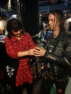 Mikannibal (of Sigh) Teaching Erik Danielsson (of Watain) how to play saxophone.
