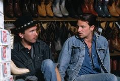 U2 ~ The Edge  Bono picking out cowboy boots and hats, during the JT era.